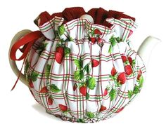 make a red one with a jagged/ leaffy top to make my tall/ oblong teapot look like a strawberry