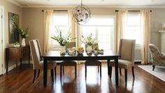 A whimsical and happy space inspired by the English and French countrysides. BLACK TABLE ONE LIGHT FIXTURE 2 CENTER PIECES