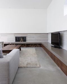 Minimal dark timber cabinetry with a thick & polished concrete top ~ Arling Residence designed by Tact Architecture