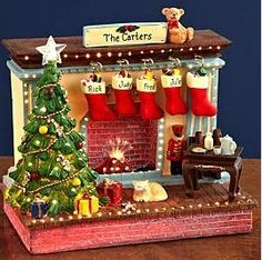 Send Fiber Optic Fireplace from Personal Creations. Christmas Gingerbread House, Christmas Fireplace, Miniature Christmas, Christmas Mood, Noel Christmas, Christmas Ornaments, Christmas Stockings, Fiber Optic Christmas Tree, Christmas Shadow Boxes