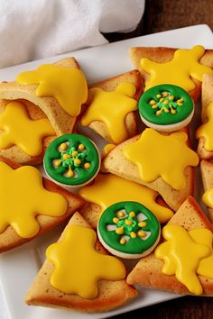 Nacho cookies are decorated sugar cookies that look like nachos with cheese & few fun jalapeno peppers.. Fun football snacks, birthday or April Fool's Day.