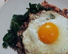 Fried Eggs with Wild Rice and Sautéed Kale Recipe   The Daily Meal