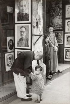Shanghai (A Father and child outside a photographer's shop, where the pictures on display are enlarged a little bigger than life-size.) Series: Chine R.P. Histoire Henri Cartier-Bresson (France, 1908-2004) China, 1949 Photographs Gelatin-silver print Image and sheet: 9 5/8 x 6 1/2 in. (24.45 x 16.51 cm) Gift of Dennis and Pamela Beck (M.2006.144.4) Photography