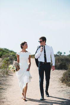 Gorgeous wedding dress and such a cute pic with her groom.
