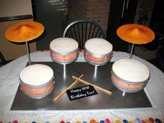 """Drum set cake - This set is nearly full size to feed 100.  2 9"""", 1 10"""" and 1 12"""" round cakes.  The cymbals are dried gumpaste as are the drumsticks.  Recipient was beyond thrilled which made all the work worth it!!"""