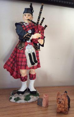 My Scottish Piper figurine with Yorkshire Terriers figurines. Karen Miniaci