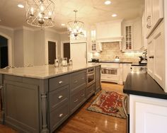 gray island, unique lighting, wood floors (go darker), white cabinets