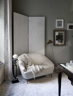 A small settee sits in front of the screen turning the spot into a workable reading nook.