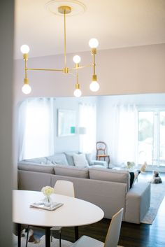 Custom-made Adel Park Studio light fixture with size mirrored pendants. A simple way to transform an apartment rental is to change out the chandelier to make the space your own. It will instant add a modern twist to your rental. Love a sculptural fixture to create a focal point in your home.