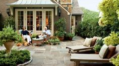 Now It's a Low-Maintenance Courtyard | These beauts are going to make you want to sit and stay a while. From screened in numbers to double stacked fixer-uppers, these porches make us want to kick up our feet and take in the view. But, they weren't always that way. Check out our best before and after porch makeovers.