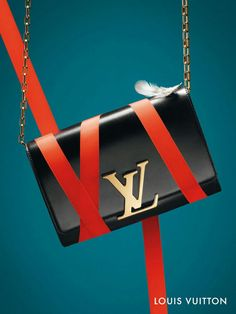 The perfect accessory for every holiday party this season: the Chain Louise from Louis Vuitton.   See more about holiday parties, louis vuitton and chains.