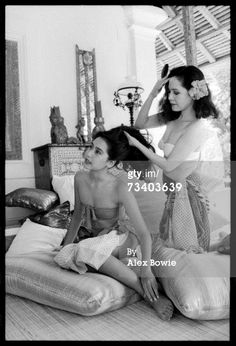 Dewi Sukarno, widow of Indonesia's founding president Sukarno, brushes her daughter Karina's hair at their seaside lodgings in Bali on her first trip back to Indonesia since the dictator died. Sukarno ruled Indonesia for 22 years, from 1945 to Dutch East Indies, World Most Beautiful Woman, My Heritage, Founding Fathers, Presidents, Culture, History, Portrait, Couple Photos