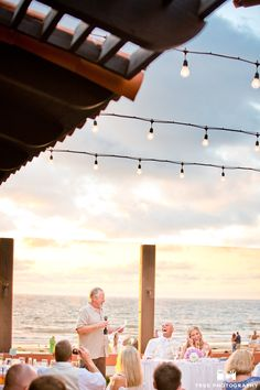 Wedding reception toasts with the sunset and ocean in the background at the La Jolla Shores Hotel.