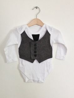 6-9mths baby waistcoat onesie/baby vest with tie, baby boy clothes, grey and black, formal baby, unique baby gift, wedding outfit. £15.50, via Etsy.