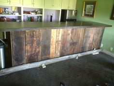 Finished this barn wood bar. Now I need to change cabinets to complement the bar.  Projects never end.