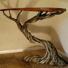 The Deadwood Table A raw slab of oak sits atop a twisted old tree in this striking combination of natural and faux wood. The Deadwood Table is a one of a kind functional sculpture that will make a (Cool Furniture Wood) Driftwood Furniture, Log Furniture, Driftwood Art, Unique Furniture, Furniture Design, Driftwood Table, Natural Furniture, Contemporary Furniture, Furniture Ideas