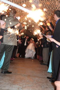 fun wedding picture ; )  It was difficult for me to get this shot, sparklers kept going in front of them, and my camera.  Glad a captures a couple good ones.