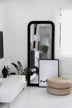 Incorporate a bolder note to the all-white space with statement mirror in a thick black frame. Couple the piece with a framed graphic print and lean against the wall for an effortless feel.