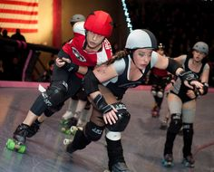 From the Gotham City All Stars v. LA Derby Dolls Ri-Ettes bout, which took place on the banked track this past weekend (Gotham is a flat track team). Haught Wheels (LA) tries to stop the unstoppable Bonnie Thunders (Gotham). Photo by Snap Shock.