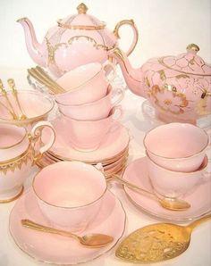 Beautiful pink tea set with gold trim.