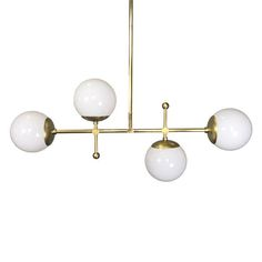 The horizontal Deko globe chandeliers linear shape offers a modern take on traditional globe chandelier design. The fixture is well suited above long bars and long tables and offers several adornment decoration options to suit your taste. Measurements: - Width: 35 in - Height: 21 - 33 in