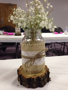 The centerpieces I made for my bridal Shower. Mason Jars with Burlap and Lace. Wrapped with twine and filled with baby's breath and twigs that I spray painted gold. #Wedding #BridalShower #DIY