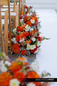 Perfect way to add color to your aisle! #Weddings by Michael Daigian Design