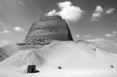 Photograph taken in Egypt. 2006.  The pyramid at Meidum is thought to originally have been built for Huni, the last pharaoh of the Third Dynasty, and was continued by Sneferu.