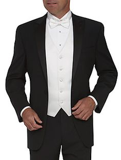 My wedding tux. Trade the white bow tie for black and the white vest with a black cummerbund and you have one dapper-looking dude!