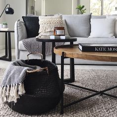 Jute natural rug + light grey couch + wood coffee table