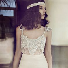 The way the straps have little shoulder caplets that are shown off beautifully with shoulder-length hair. | 50 Gorgeous Wedding Dress Details That Are Utterly To Die For
