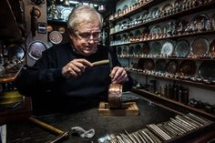 Photo by @stillerakos // A coppersmith works in the Bascarsija in Sarajevo. In the 16th century the bazaar had many thousand commercial and craft shops most of which were destroyed due to a large fire in the 19th century. Shot #onassignment for @natgeotravel. Follow @stillerakos for more! by natgeotravel