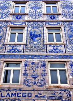 Tiled and painted facade of a building in Lisbon, Portugal by Adri  Padmos