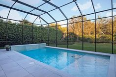 This small private pool features a waterfall from the low wall at the end of the pool and a shallow section to sit and soak. The solarium helps to keep the pool warm and protected from the elements without taking away from the surrounding view.