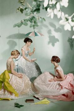 Young ladies with books in Charles James' candy-colored gowns. Vogue (1948). Photograph by Sir Cecil Beaton (1904-1980).