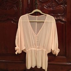 Size Medium Sheer Dressy Light Peach Color Blouse. Size Medium Sheer Dressy Peace Color Blouse. Worn a couple of and in excellent condition. No issues. Unknown Tops