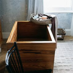 Japanese teak bathtub. I love that they sit upright.