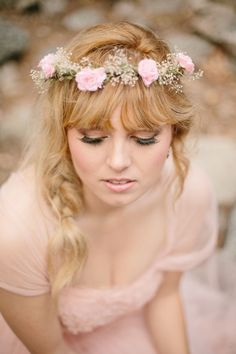 Perfection in a single side braid, flower circlet, and full bangs.
