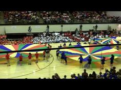 "A parachute routine to the song ""Under The Sea"" from the Little Mermaid. Students had to listen to the form."