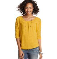 Scoop Neck Dolman Sleeve Tee - Dropped dolman sleeves - and hints of gathered detail - give this jersey knit tee stylishly easygoing appeal. Scoop neck. 3/4 dolman sleeves. Gathered beneath banded neckline. Drop shoulders. Banded cuffs and hem.