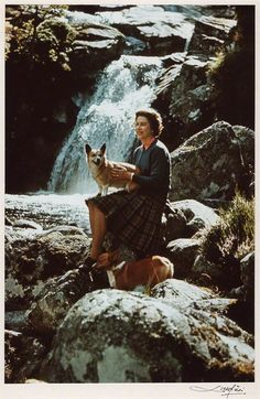Queen Elizabeth with two of her corgis at Balmoral