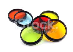 Pile of colored lens filters on white background royalty-free stock photo