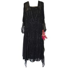Preowned 1920s Heavily Beaded & Sequin Silk Chiffon Flapper Dress (£740) ❤ liked on Polyvore featuring dresses, 1920s, vintage, black, vintage dresses, sleeve cocktail dress, long sleeve cocktail dresses, sequin cocktail dresses and cocktail dresses