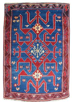"""Avar, Late 19th C, Caucasus - Avar pile rugs form a rare & distinct weaving group from the Caucasus. The design of this piece is quintessentially Avar & relates to much larger long Avar kilims depicting stylized dragons rendered here with more geometric drawing. The simple vine-scroll border further relates to flatwoven examples. Interestingly, the intensity of contrasting blue & red is elevated in this example with vibrant middle blue & both a vibrant madder red & burgundy. W: 3' 0"""" x L: 4'…"""