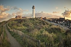 Photo about Lighthouse in coastal village of Egmond aan Zee (municipality of Bergen), Netherlands at sunrise. Image of sunrise, village, horizontal - 33295776 Day Trips From Amsterdam, I Amsterdam, Urban Landscape, Belle Photo, Landscape Photography, Nature Photography, Places To See, Beautiful Places, Amazing Places
