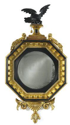 part-ebonized giltwood octagonal convex mirror circa 1810