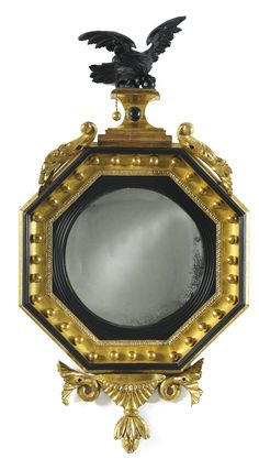 A REGENCY PART-EBONIZED GILTWOOD OCTAGONAL CONVEX MIRROR CIRCA 1810