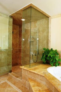 Transitional Master Bathroom with small brown stone tile shower flooring
