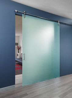 Sliding Glass Barn Door Used In An Office Waiting Room. Installed With  Frameless Frosted Glass.