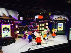 The entire Peanuts gang is featured in the holiday windows.